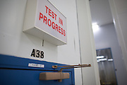 "The entrance to a Ritchey-Common optical test facility at Exelis Inc. in Rochester, New York on September 10, 2014. The chamber allows for precise testing of optical surfaces in a ""zero-G simulated environment."""
