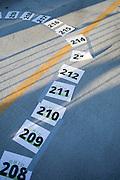 Numbered spaces line the parking lot outside of Baker Center after BobcaThon's cake walk on October 5, 2016.