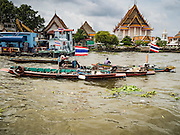 06 OCTOBER 2015 - BANGKOK, THAILAND:  Salvage divers work the Chao Phraya River in Bangkok. Divers work in two man teams on small boats in the Chao Phraya River. One person stays in the boat while the diver scours the river bottom for anything that can be salvaged and resold. The divers usually work close to shore because the center of the river is a busy commercial waterway with passenger boats and commercial freight barges passing up and down the river all day long. The Chao Phraya is a dangerous river to dive in. It's deep, has large tidal fluctuations, is fast flowing and badly polluted. The divers make money only when they sell something.    PHOTO BY JACK KURTZ