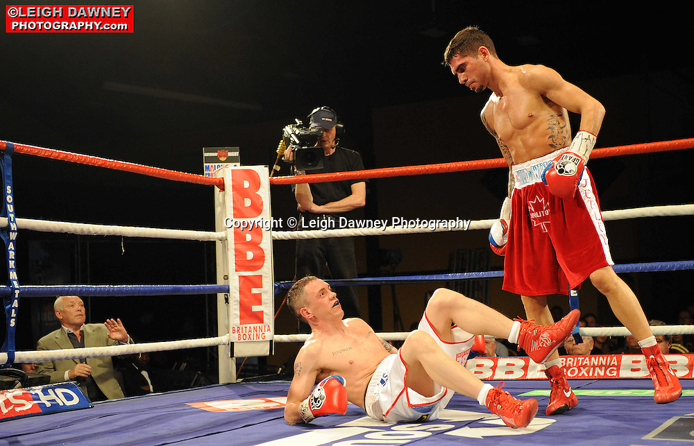 Steve Molitor (red shorts) defeats Jason Booth for IBF Super Bantamweight title at Rainton Meadows Arena, Sunderland, 11th September 2010. Frank Maloney Promotions. © Photo credit: Leigh Dawney