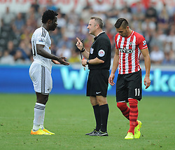 Swansea City's Wilfried Bony confronts referee after getting his red card. - Photo mandatory by-line: Alex James/JMP - Mobile: 07966 386802 20/09/2014 - SPORT - FOOTBALL - Swansea - Liberty Stadium - Swansea City v Southampton  - Barclays Premier League