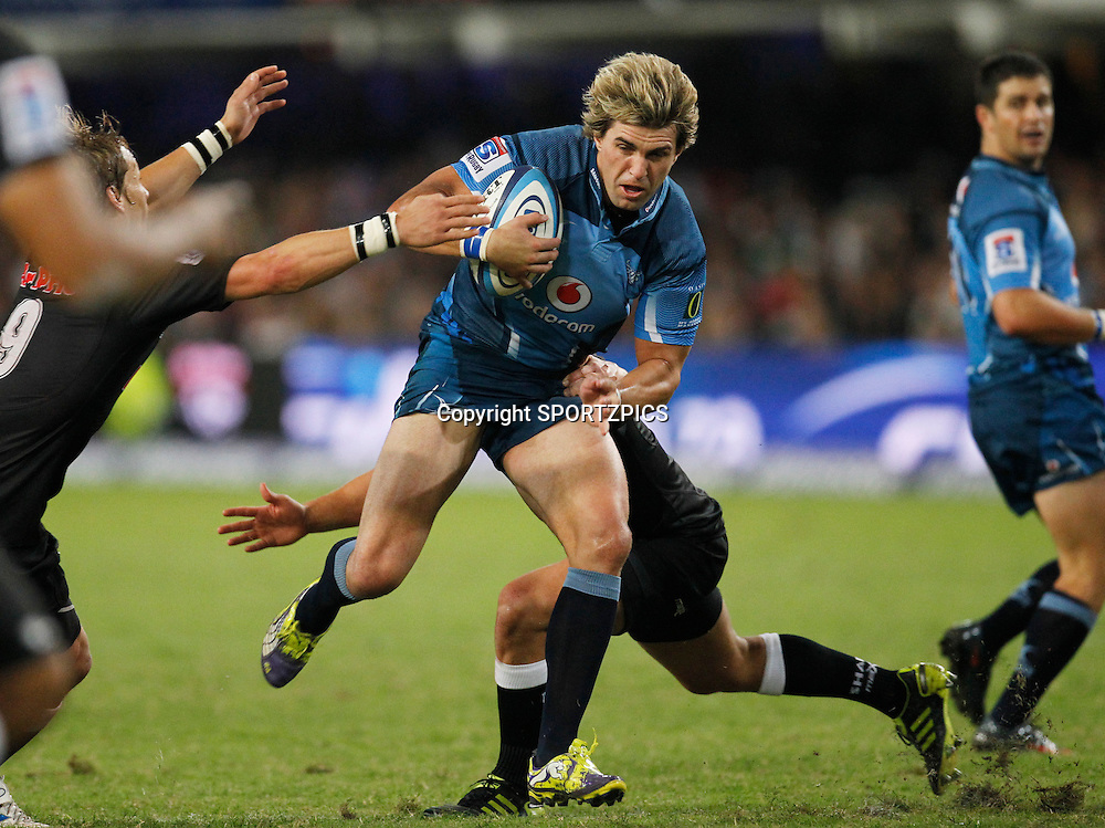 Wynand Olivier runs with the ball during the Super 15 match between the Sharks and the Bulls played in Durban on the 21 May 2011..Photo by: SPORTZPICS