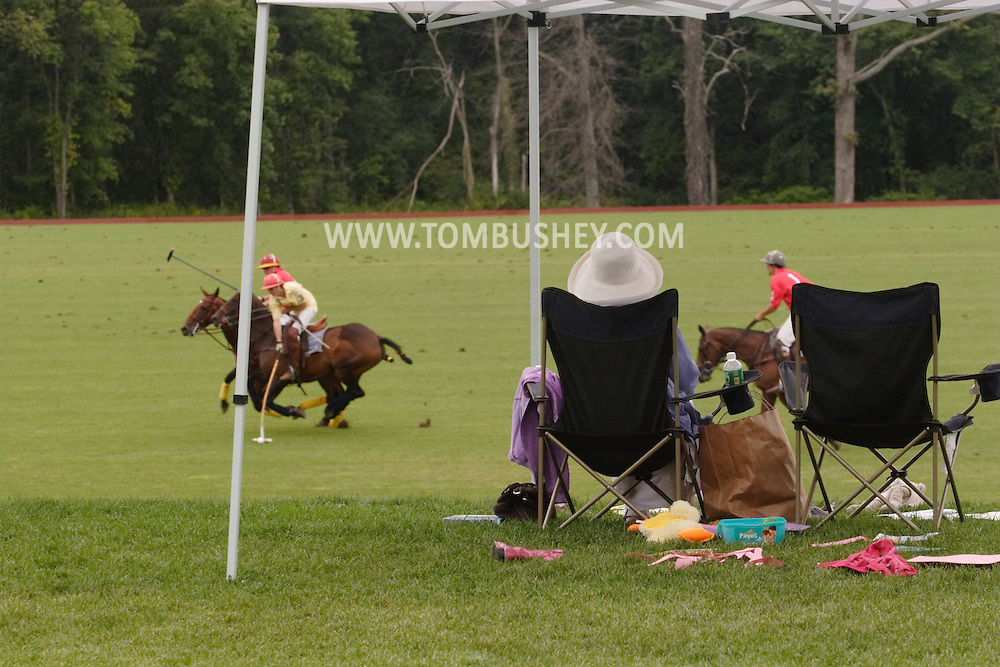 Town of Wallkill, NY - A woman watches a polo match at the Blue Sky Polo Club on Aug. 19, 2007l
