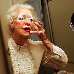 """Rosie"" takes her time applying her clown make-up. Orline Olin ,86,  of Altadena  or as she is better known ""Rosie the Clown"" entertains both young and old at the Scripps Home in Altadena February 8. 2006."