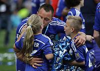 Football - 2014 / 2015 Premier League - Chelsea vs. Sunderland.   <br /> <br /> John Terry of Chelsea FC kisses his daughter after the trophy celebration at Stamford Bridge. <br /> <br /> COLORSPORT/DANIEL BEARHAM