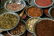 Dishes of dried herbs and spices