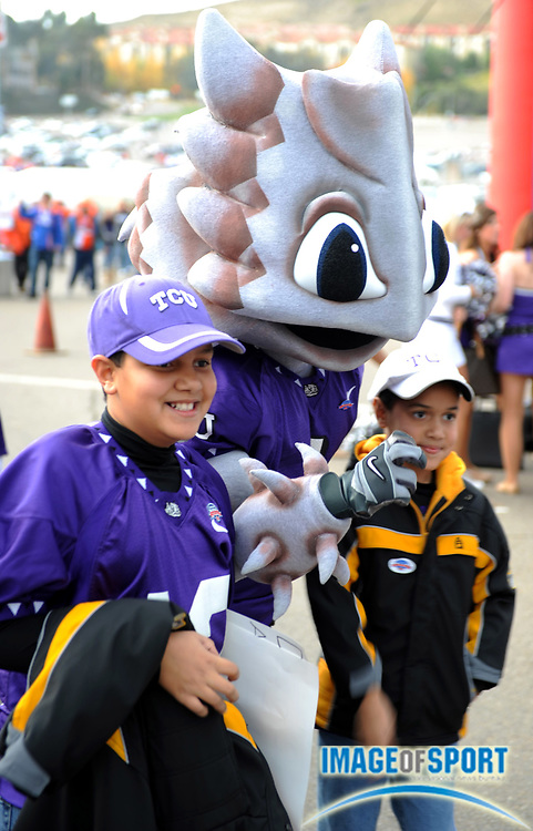 Dec 23, 2008; San Diego, CA, USA; Texas Christian Horned Frogs mascot poses with youngsters during tailgate festivities before the game against the Boise State Broncos in the Poinsettia Bowl at Qualcomm Stadium.