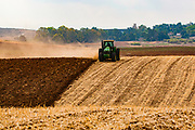 Tractor ploughing a wheat field, Negev Desert, Israel
