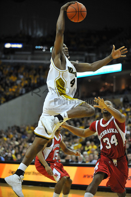 Jan 23, 2010; Columbia, MO, USA; Missouri Tigers guard J.T. Tiller (4) goes up for a shot as Nebraska Cornhuskers guard Lance Jeter (34) attempts to block in the second half at Mizzou Arena in Columbia, MO. Missouri won 70-53. Mandatory Credit: Denny Medley-US PRESSWIRE