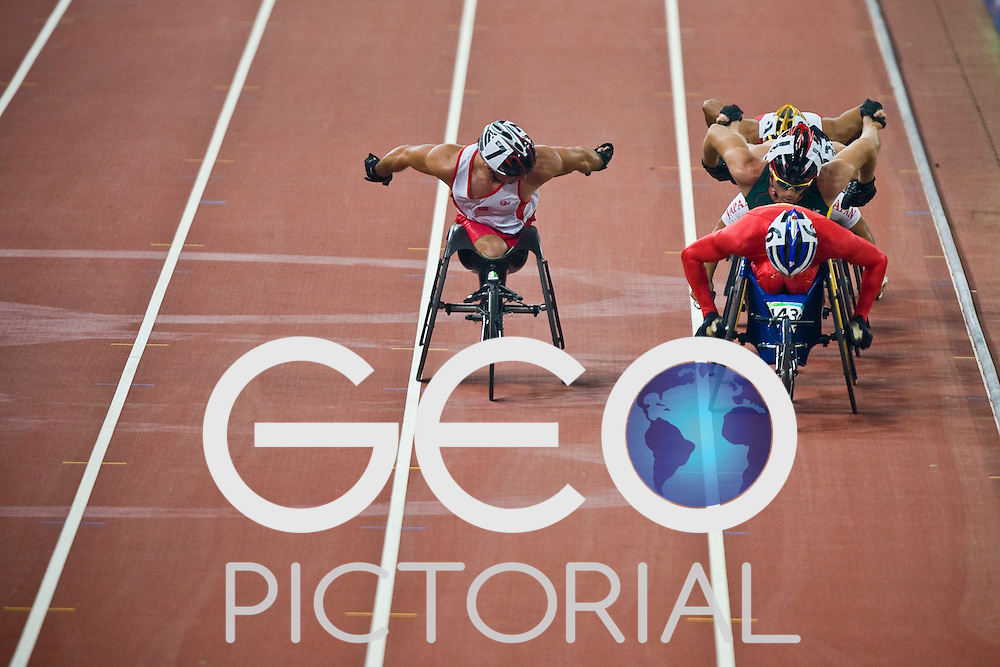 """Men's T54 5000m first heat during the Beijing 2008 Paralympic Games at the National """"Bird's Nest"""" Stadium in Beijing China on the 8th September 2008;"""