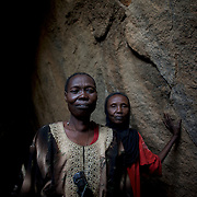 April 28, 2012 - Tabania, Nuba Mountains, South Kordofan, Sudan: Nuba women take cover from possible bombardments by Sudan's Army Forces airplane in some caves near Buram village. Since the 6th of June 2011, the Sudan's Army Forces (SAF) initiated, under direct orders from President Bashir, an attack campaign against civil areas throughout the South Kordofan's province. Hundreds have been killed and many more injured...Local residents, of Nuba origin, have since lived in fear and the majority moved from their homes to caves in the nearby mountains. Others chose to find refuge in South Sudan, driven by the lack of food cause by the agriculture production halt due to the constant bombardments of rural areas.
