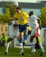 Photo: Ed Godden.<br /> Milton Keynes Dons v Hereford United. Coca Cola Championship. 21/10/2006. Hereford's Alex Jeannin heads the ball out of the Hereford area.