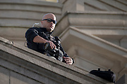 A Secret Service Agent scans the area where Vice President Mike Pence is scheduled to watch the Savannah St. Patrick's Day parade, Saturday, March 17, 2018, in Savannah, Ga. (AP Photo/Stephen B. Morton)