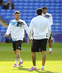 Sevilla's Alberto Moreno shares a joke with Sevilla's Jose Antonio Reyes - Photo mandatory by-line: Joe Meredith/JMP - Mobile: 07966 386802 11/08/2014 - SPORT - FOOTBALL - Cardiff - Cardiff City Stadium - Real Madrid v Sevilla - UEFA Super Cup - Press Conference and Open Training session