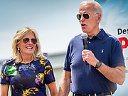 08 AUGUST 2019 - DES MOINES, IOWA: JILL BIDEN, left, and her husband, former Vice President JOE BIDEN, take the stage at the Des Moines Register Political Soapbox at the Iowa State Fair. Vice President Biden spoke at the Des Moines Register Political Soapbox at the Iowa State Fair Thursday. Biden is running to be the Democratic nominee for President in 2020. Iowa holds the first selection event of the 2020 election cycle. The Iowa Caucuses are on February 3, 2020.    PHOTO BY JACK KURTZ