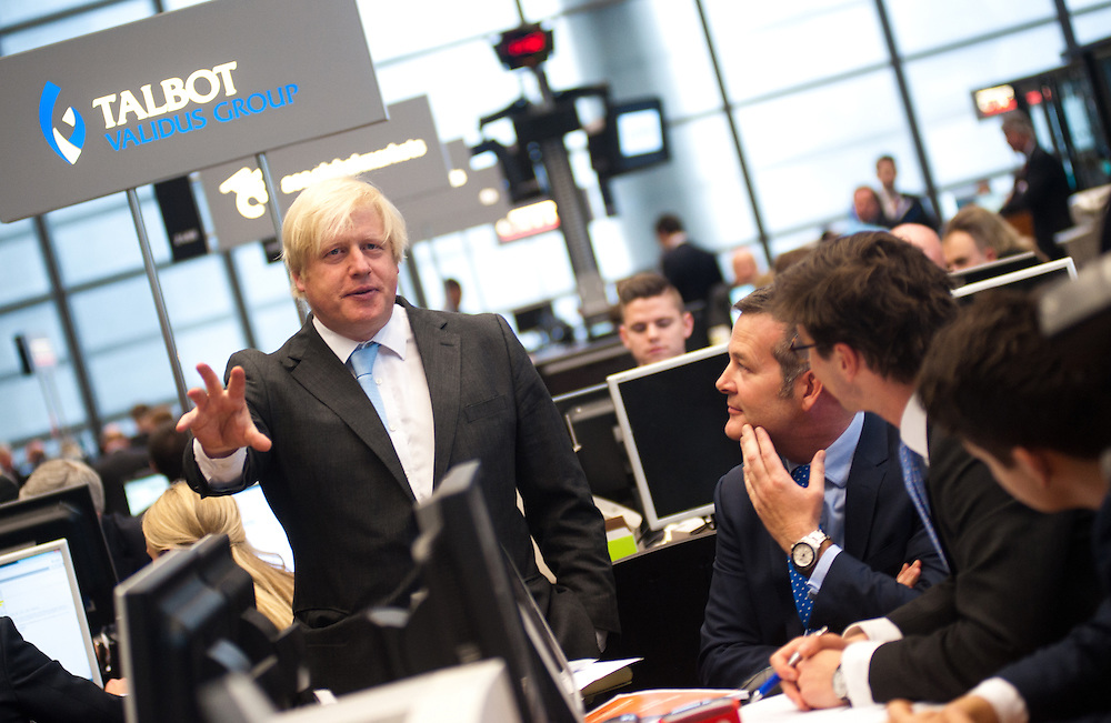 London, UK – 24 June 2013: The Mayor Boris Johnson speaks to Lloyd's of London staff in the London iconic building's Underwriting Room by the Lutine Bell, to champion London's insurance sector and build on its status as a global hub.