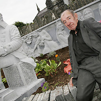 Michael Clancy wonders who's the new man in town as a statue of poet Brian Merriman was erected outside Teach Ceoil in Ennistymon on Wednesday.<br /> <br /> Photograph by Yvonne Vaughan.