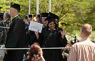 Middletown, NY - A graduate smiles after receiving her diploma during the 58th commencement at Orange County Community College on May 17, 2008.