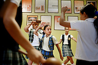 Carelis Padilla, 8, practices a folklorico dance with other students at the Instituto de Cultural Puertorriqueña, a cultural center in Jayuya, Puerto Rico, on Monday, November 17, 2008. Residents celebrate the 39th annual Festival Indigena de Jayuya, which honors their Taino Indian heritage, this weekend. This festival theme this year are musical instruments used by the Taino.