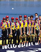 Sydney, AUSTRALIA, ROM W8+ on medal pontoon, after winning the gold medal in the women's eights, at the 2000 Olympic Regatta, Penrith Lakes. [Photo Peter Spurrier/Intersport Images]  [left to right] bow, DAMIAN, Georgeta, SUSANU Viorica, OLTEANU Ioana, COCHELEA Veronica, DUMITRACHE Maria Magdalena, LIPA Elisabeta, GAFENCU Liliana, stroke,.IGNAT Doina and cox GEORGESCU Elena. 2000 Olympic Regatta Sydney International Regatta Centre (SIRC) 2000 Olympic Rowing Regatta00085138.tif