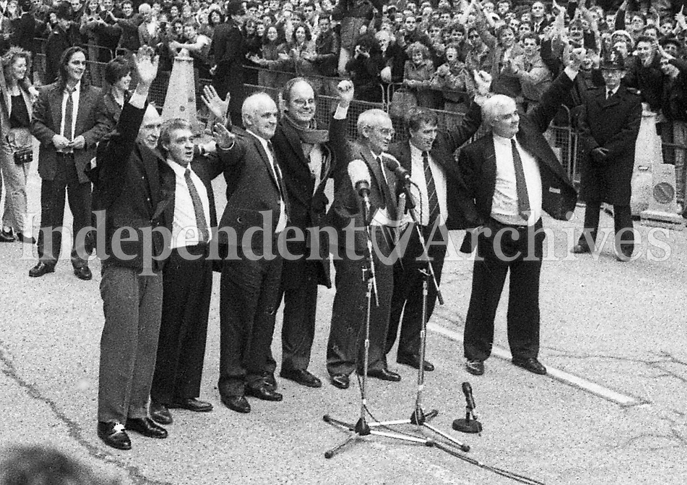 The Birmingham Six wave to relatives and well-wishers outside the Old Bailey following their release from the Court in London. Chris Mullin MP with from left: John Walker, Paddy Hill, Hugh Callaghan, Richard McIlkenny, Gerry Hunter and William Power. 14/3/1991. (Part of the Independent Newspapers Ireland/NLI Collection)