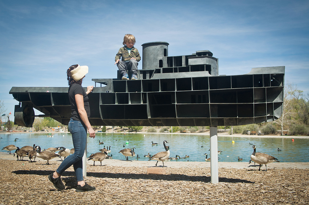mkb040617c/metro/Marla Brose --  Ian Albright, 3, plays on a sculpture with his mother Anna Kucharz at Tingley Beach's Model Boat Pond, Thursday, April 6, 2017, in Albuquerque, N.M.(Marla Brose/Albuquerque Journal)