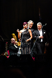 ANAHEIM, CA - JUN 9: Italian tenor Andre Bocelli performed Granada, New York, La Boheme, LaTraviata among others keeping audience mesmerized at the Honda Center in Anaheim, CA. The magical night included producer David Foster on Piano, Violinist Caroline Campbell, American Idol Season 3 winner Soul Singer Fantasia, Cuban Soprano Maria Aleida and Orchestra Conductor Eugene Kohn. Soul Singer Fantasia (L), Andrea Bocelli (C) and Conductor Eugene Kohn (R) enter the stage. All fees must be agreed prior to publication, Byline and/or web usage link must  read  PHOTO: SilvexPhoto.com