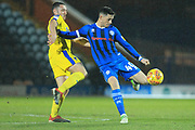 Ian Henderson shoots during the EFL Sky Bet League 1 match between Rochdale and AFC Wimbledon at Spotland, Rochdale, England on 19 February 2019.