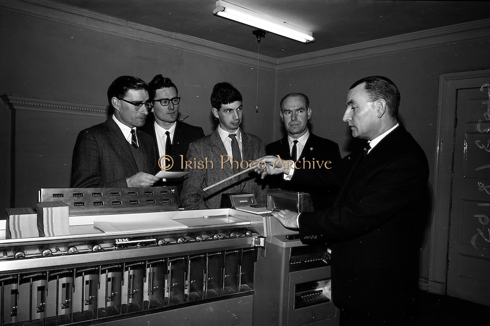 6/3/1965<br /> 3/6/1965<br /> 6 March 1965<br /> <br /> Mr. J.J. Jones Managing Director explaining data processing equipment to R. Keenan C.I.E Hugh O'Dobbell, Ian Philips and Brendan O'Connor