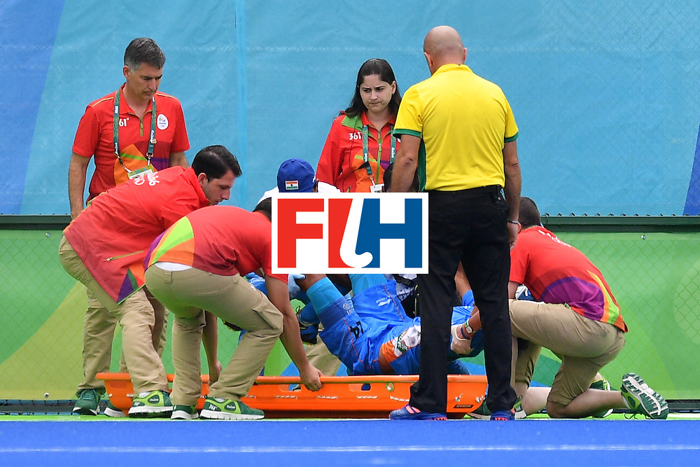India's Sunil Sowmarpet is stretchered off after an injured during the mens's field hockey India vs Canada match of the Rio 2016 Olympics Games at the Olympic Hockey Centre in Rio de Janeiro on August, 12 2016. / AFP / Carl DE SOUZA        (Photo credit should read CARL DE SOUZA/AFP/Getty Images)