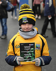 Young Cian O&rsquo;Malley from Louisbugh with a match program, a lot of supporters were unable to avail of programme&rsquo;s due to the huge crowd.<br />