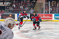 KELOWNA, BC - OCTOBER 12: Jake Poole #23 and Trevor Wong #8 of the Kelowna Rockets skate against the Kamloops Blazers at Prospera Place on October 12, 2019 in Kelowna, Canada. (Photo by Marissa Baecker/Shoot the Breeze)