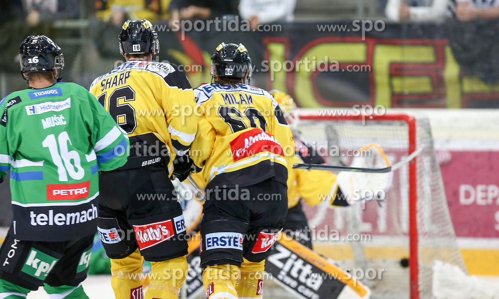 27.09.2015, Albert Schultz Halle, Wien, AUT, EBEL, UPC Vienna Capitals vs HDD TELEMACH Olimpija Ljubljana, 6. Runde, im Bild Ales Music (HDD TELEMACH Olimpija Ljubljana) , MacGregor Sharp (Vienna Capitals) und Troy Milan (Vienna Capitals) // during the Erste Bank Icehockey League 6th round match between UPC Vienna Capitals and HDD TELEMACH Olimpija Ljubljana at the Albert Schultz Halle in Vienna, Austria on 2015/09/27. EXPA Pictures © 2015, PhotoCredit: EXPA/ Alexander Forst