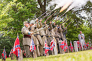 Civil War re-enactors fire their rifles during Confederate Memorial Day events at Magnolia Cemetery April 10, 2014 in Charleston, SC. Confederate Memorial Day honors the approximately 258,000 Confederate soldiers that died in the American Civil War.