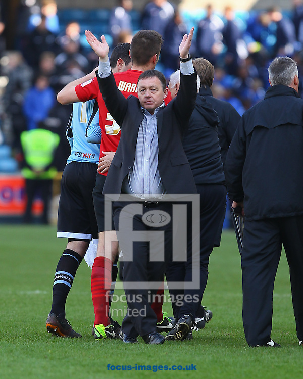 Picture by John Rainford/Focus Images Ltd +44 7506 538356.27/04/2013.Manager Billy Davies of Nottingham Forest waves to the away fans after the npower Championship match at The Den, London.