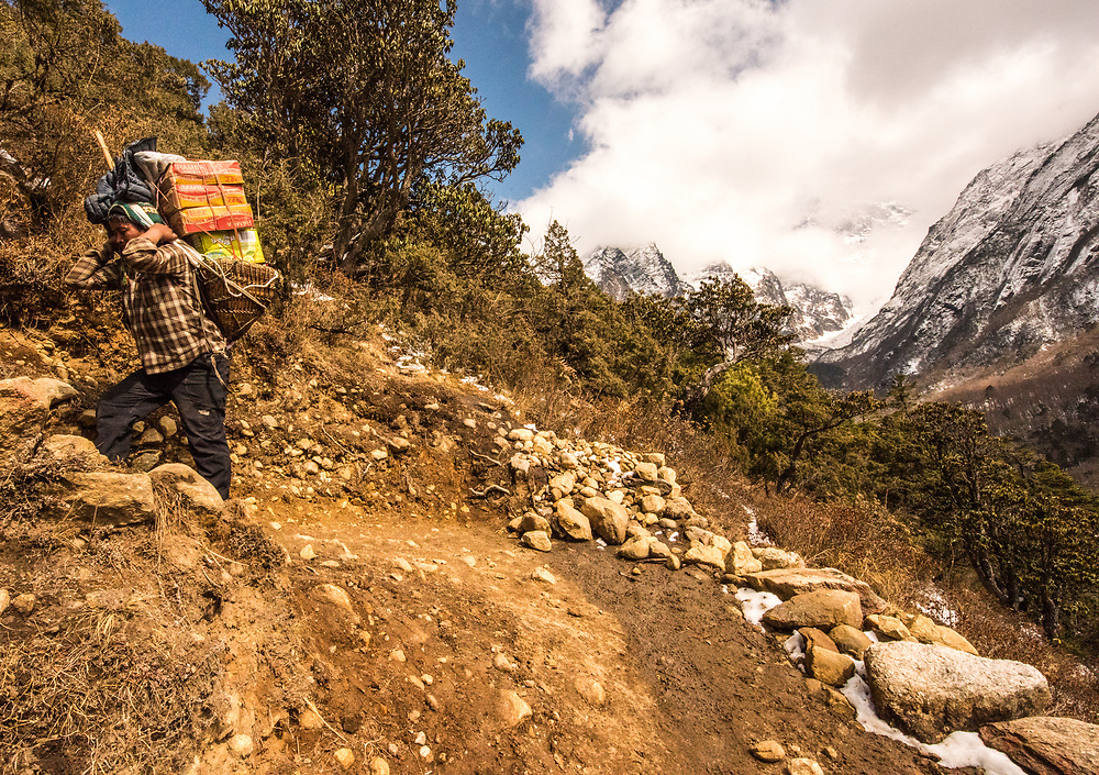 Winding through the remote Solukhumbu region of the Himalayas in Nepal, the Everest Trail meanders along hard trails of frozen earth, through crisp snow covered trails, seemingly endless stepped rocky ascents and truly awesome descents punctuated with single track wired suspension bridges.