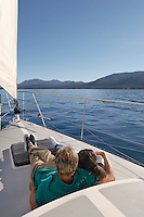 Couple Sitting on Deck of Sailboat
