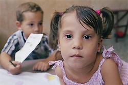 Portrait of nursery school girl looking serious,