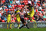 Burton Albion's Hope Akpan and Sunderland's Lee Cattermole during the EFL Sky Bet Championship match between Sunderland and Burton Albion at the Stadium Of Light, Sunderland, England on 21 April 2018. Picture by John Potts.