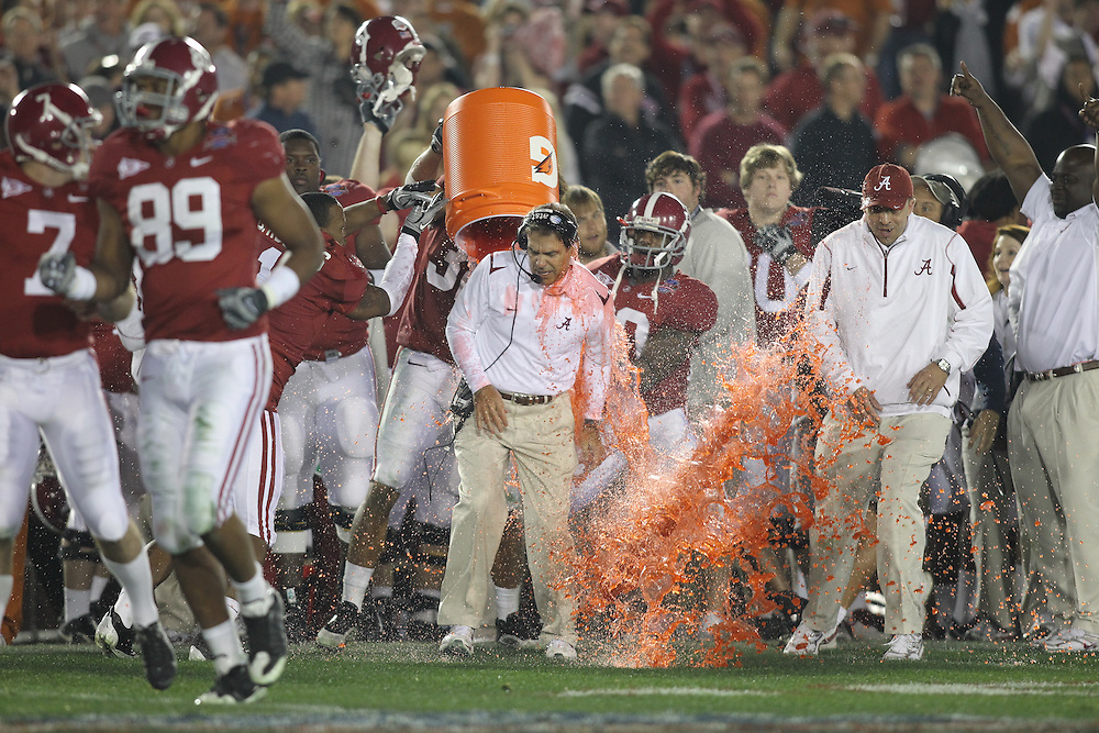 PASADENA,CA - JANUARY 07:  Head Coach Nick Saban of the Alabama Crimson Tide has gatorade dumped on him celebrating theAlabama Crimson Tide's victory over Texas Longhorns 37-21 in the BCS National Championship game on January 7, 2010 at the Rose Bowl in Pasadena, CA. Photo by Tom Hauck.