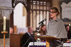 © Licensed to London News Pictures.  17/11/2013. THAME, UK. A&E Consultant Dr Eleanor Beswick reads from the bible during the annual Road Deaths Memorial Service held in St Marys Church, Thame. 78 people were killed in traffic accidents in the Thames Valley Police area last year.  Photo credit: Cliff Hide/LNP