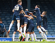 Southend player Adam Barrett is mobbed after opening the scoring during the Sky Bet League 1 match between Southend United and Peterborough United at Roots Hall, Southend, England on 5 September 2015. Photo by Bennett Dean.