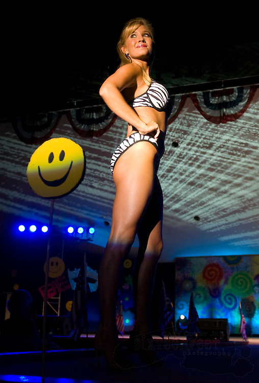 Photo by Gary Cosby Jr.  Susannah Higgins models a swimsuit as she competes in the Spirit of America Pageant on the Spirit of America Stage in Point Mallard Park Saturday night.