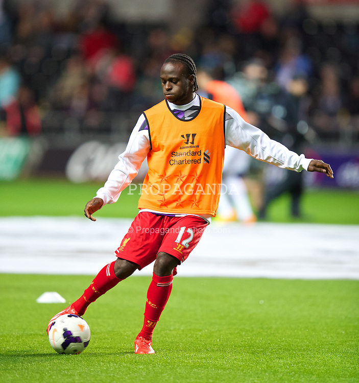 SWANSEA, WALES - Monday, September 16, 2013: Liverpool's Victor Moses warms-up before the Premiership match against Swansea City at the Liberty Stadium. (Pic by David Rawcliffe/Propaganda)