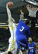 December 17, 2011: Iowa Hawkeyes forward Andrew Brommer (20) puts up a shot as Drake Bulldogs guard Kurt Alexander (3) defends during the the NCAA basketball game between the Drake Bulldogs and the Iowa Hawkeyes at Carver-Hawkeye Arena in Iowa City, Iowa on Saturday, December 17, 2011. Iowa defeated Drake 82-68.