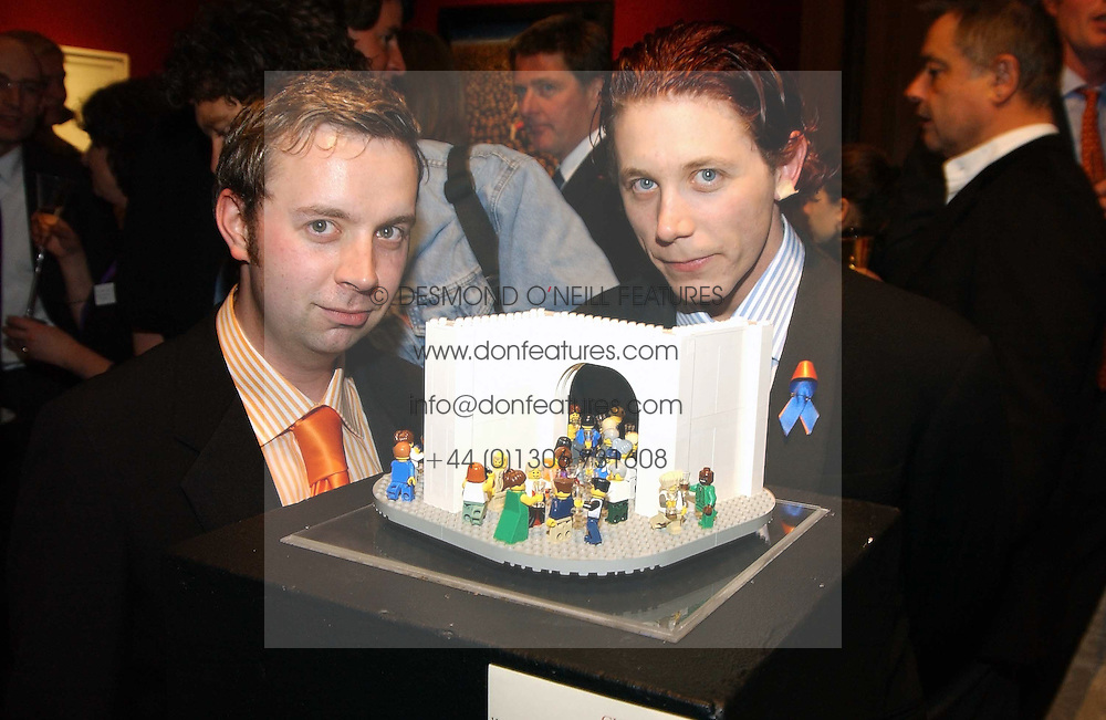 Left to right, Artist duo 'THE LITTLE ARTISTS' DARREN NEAVE and JOHN CAKE at an aution of art inspired by footballer David Beckham in aid of The National Deaf Children's Society and held at Christie's, St.James's, London on 4th November 2004.<br />