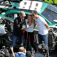 Movie director Michael Bay (left), actors Josh Duhamel (center) and Rosie Huntington-Whiteley give the command to start engines prior to the Daytona 500 at Daytona International Speedway on February 20, 2011 in Daytona Beach, Florida. (AP Photo/Alex Menendez)