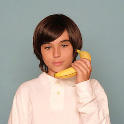 Boy Holding Banana as if Telephone
