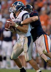 Virginia defensive end Chris Long (91) sacks Connecticut quarterback Tyler Lorenzen (4)..The Virginia Cavaliers defeated the Connecticut Huskies 17-16 at Scott Stadium in Charlottesville, VA on October 13, 2007