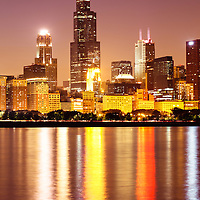 Photo of Chicago at night with Willis Tower (Sears Tower) one of the world's tallest skyscraper buildings. Picture is vertical, high resolution and was taken in October 2011.